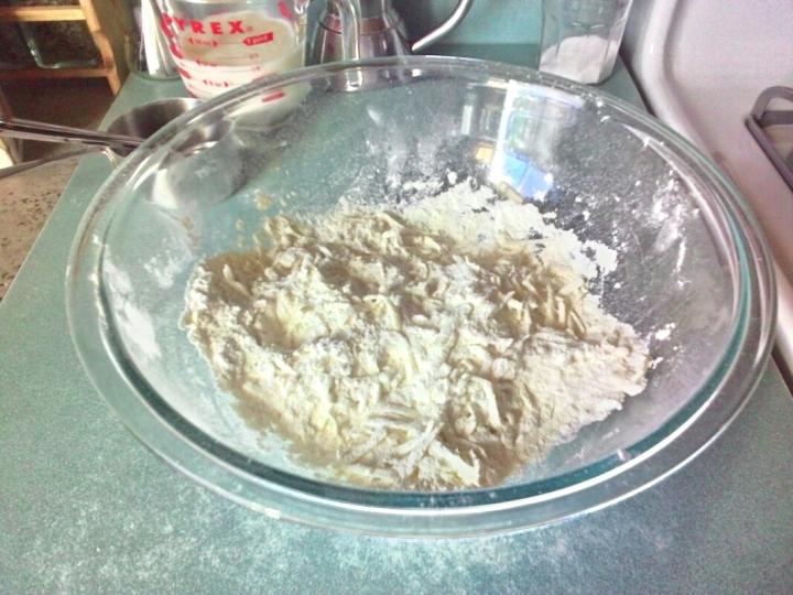 Fluff grated butter into flour mixture
