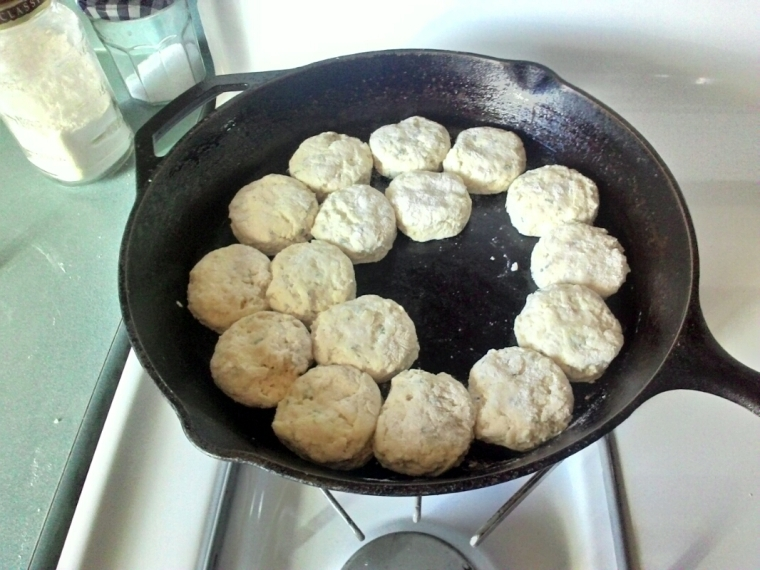 Adding biscuit rounds to the skillet